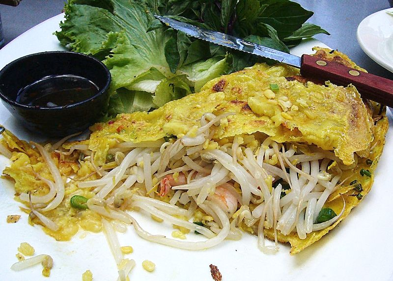Vietnamese bahn xeo is a crisp and lacy pancake (crepe) that is fried and used as a wrapper for fillings of stir fried prawns, pork and vegetables