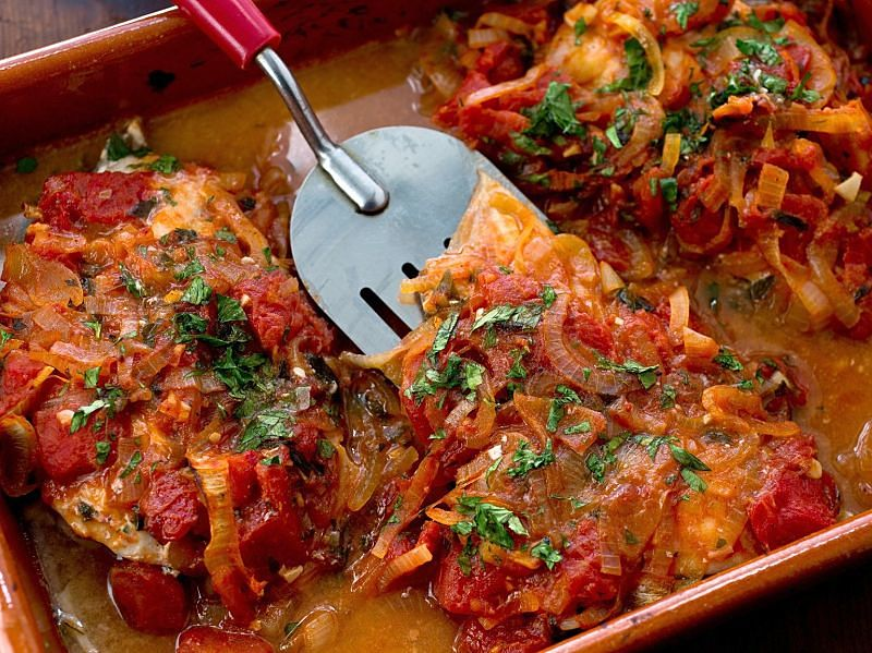 Adding vegetables onions and herbs adds to the taste and appeal of baked fish dishes