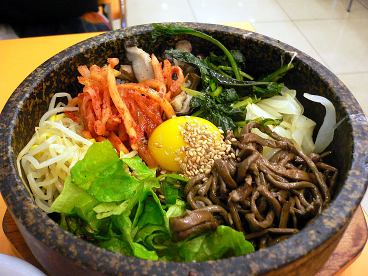 Bibimbap is a delightful Korean Dish - mixed rice served in a stone bowl. See the delightful recipes here to learn how to cook Bibimbap at home
