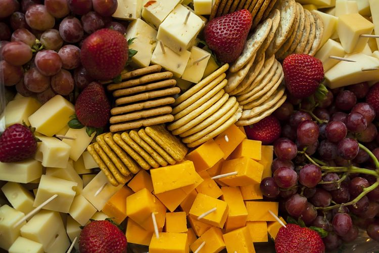 The appeal of a cheese platter is improved by the layout but nothing beats high quality attractive cheese selections