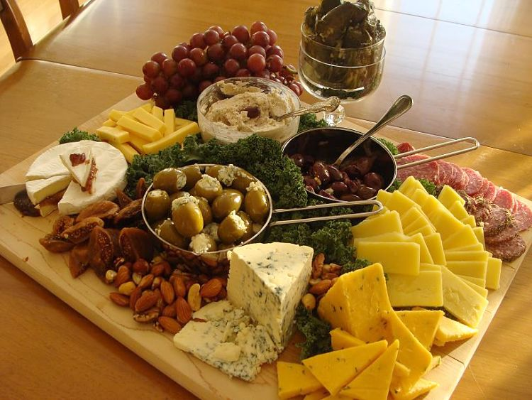 A lovely layout with a selection of cheeses, olives, fruit and nuts - Looks to good.