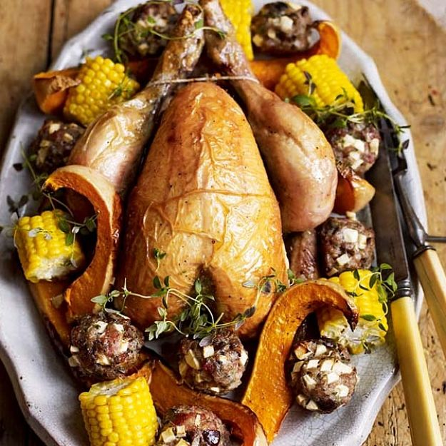 Roast chicken with chestnut and apple stuffing balls - see more recipes here