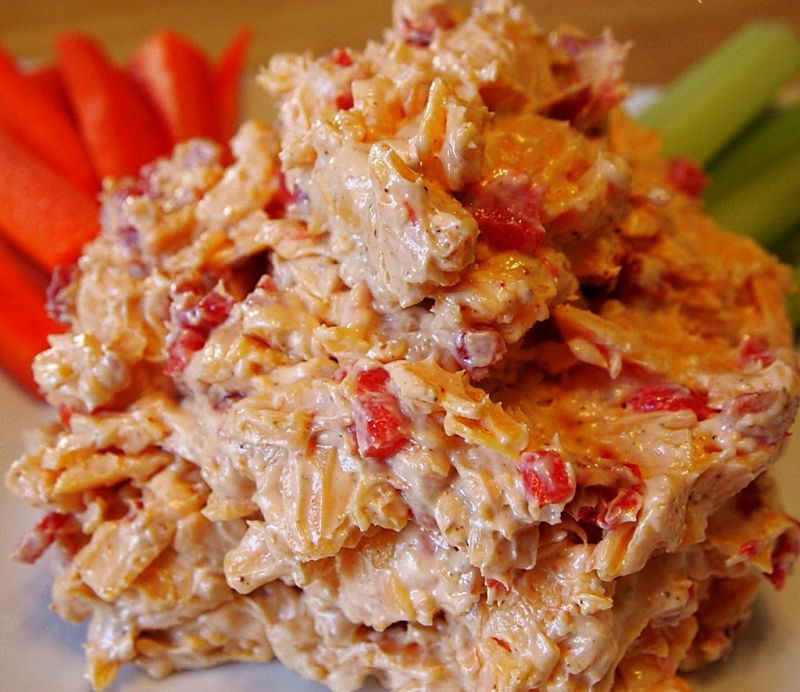 The texture of the pimento cheese can be adjusted by grating the cheese coarsely or finely, how finely the pimento is chopped and by using a food processor.