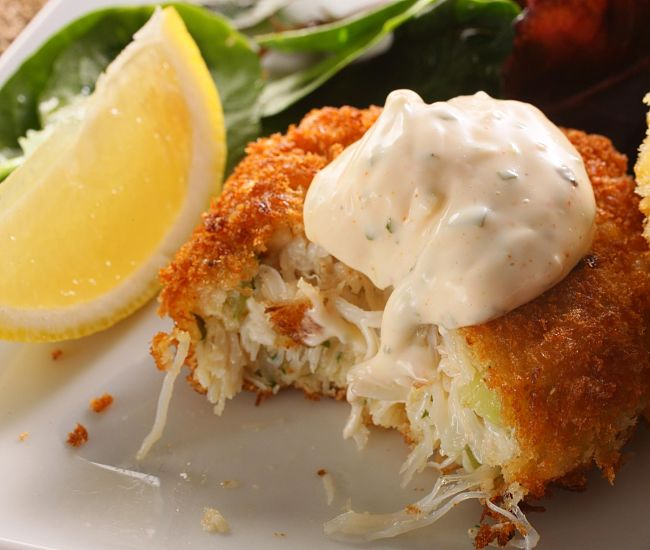 A spicy white sauce with fresh herbs is a great addition for homemade crab cakes