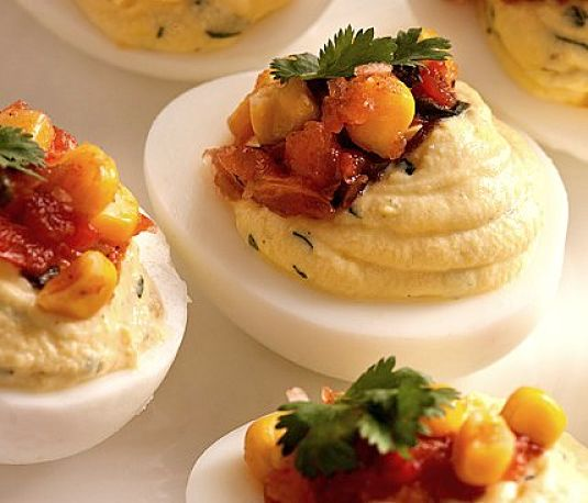 Deviled eggs with herbs and crispy bacon - see more recipes here