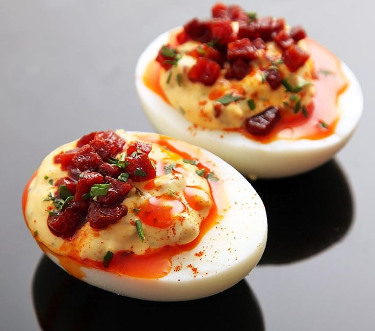 Deviled eggs with crisp fried Spanish chorizo and sherry vinegar, bright red chorizo oil and smoked Spanish paprika