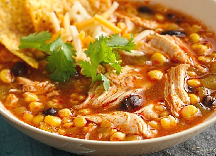 Chicken Enchilada Soup is a delight when slow cooked in a stock pot. This blends the flavors and ensures the beans are soft and the chicken tender and stringy.