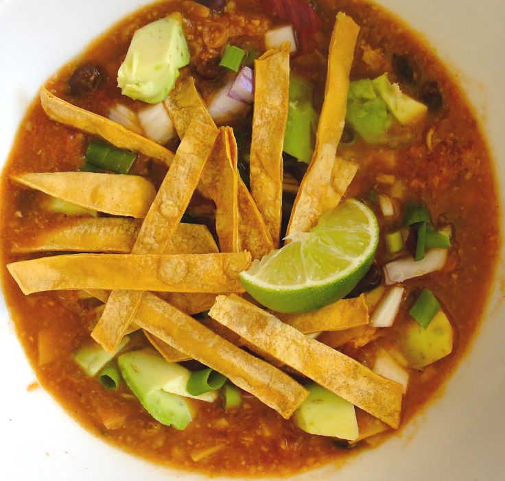 Lime, avocado, spring onion and fried tortilla strips add to the appeal of a genuine tortilla soup. Enjoy!
