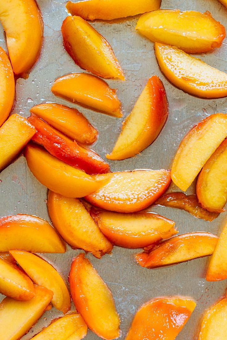 Fresh peaches - sliced and ready to freeze by placing well separated on trays