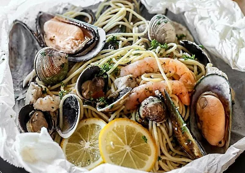 Delightful combination of fresh seafood cooked to perfection in parchment