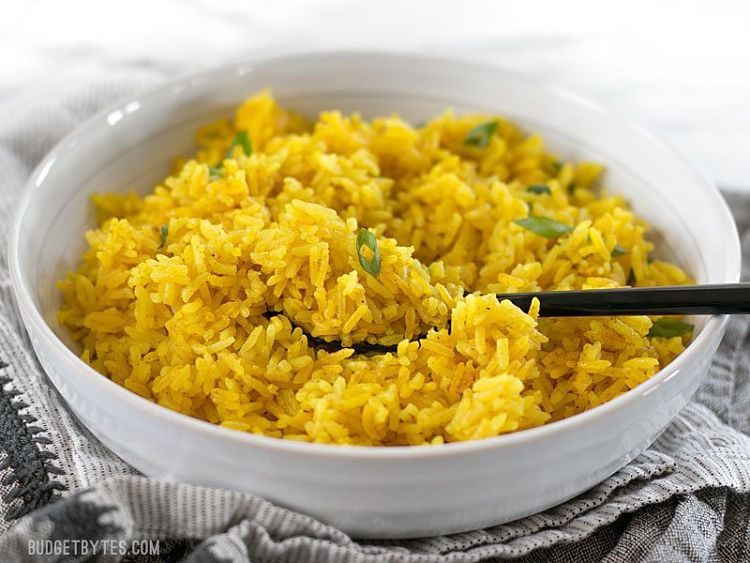 Yellow jasmine rice is a great example of a flavored rice. See the recipe hear