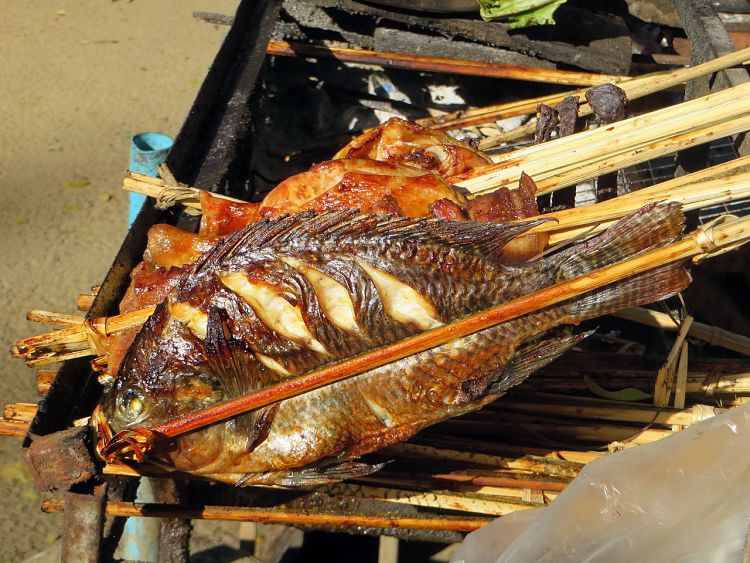Simply cooked whole fish grilled over an open flame on your barbecue