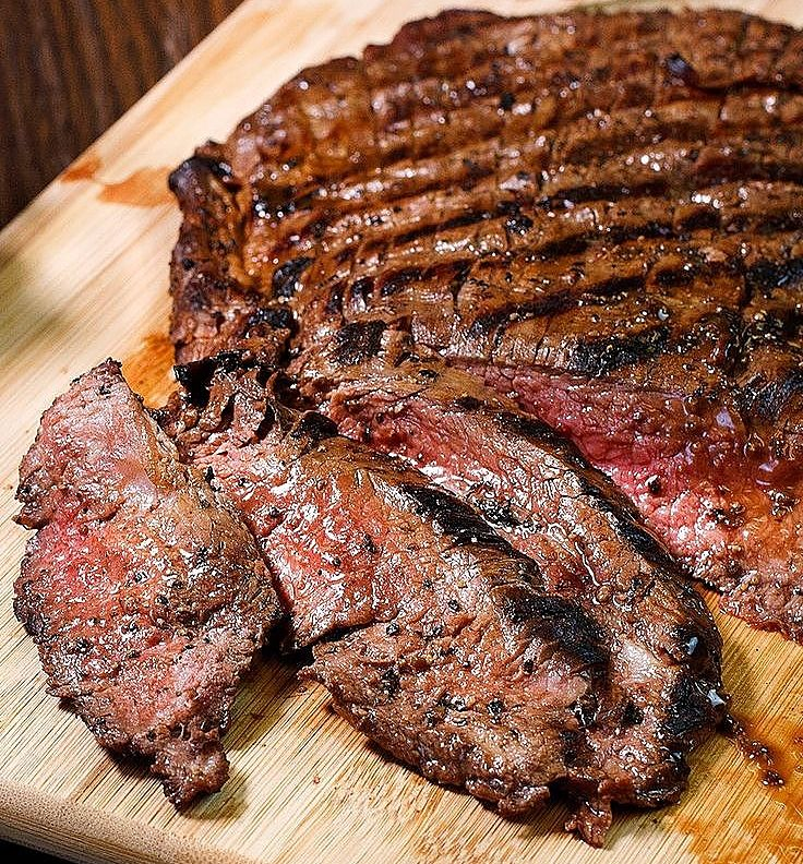 Grilled Flank Steak cooked to perfection and rested before serving