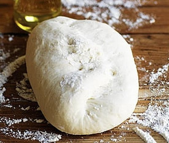 Rolling the pizza dough into a ball after kneading