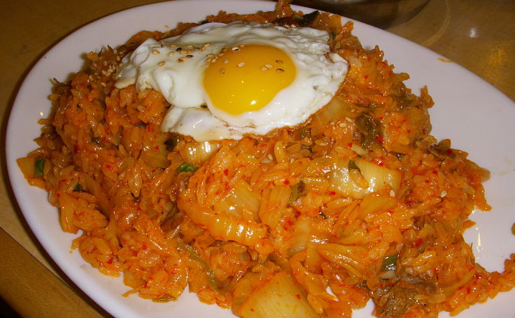 Kimchi fried rice is a traditional Korean snack food that you can make at home using this delightful collection of recipes with many variations