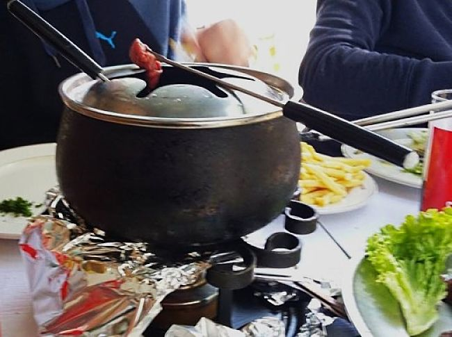 Traditional Fondue cookers can be adapted for cooking Korean barbecues. This one was used by a restaurant in Geneva, Switzerland. My family and I enjoyed the experience