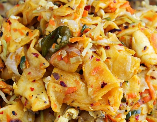 Genuine Kottu Roti, can be easily made at home from a variety of easily accessed spices, leftover curry, vegetables and your choice of meats
