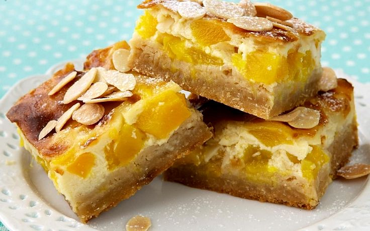 Mangoes and toasted almonds make a wonderful pair in slices, biscuits, muffins and cookies