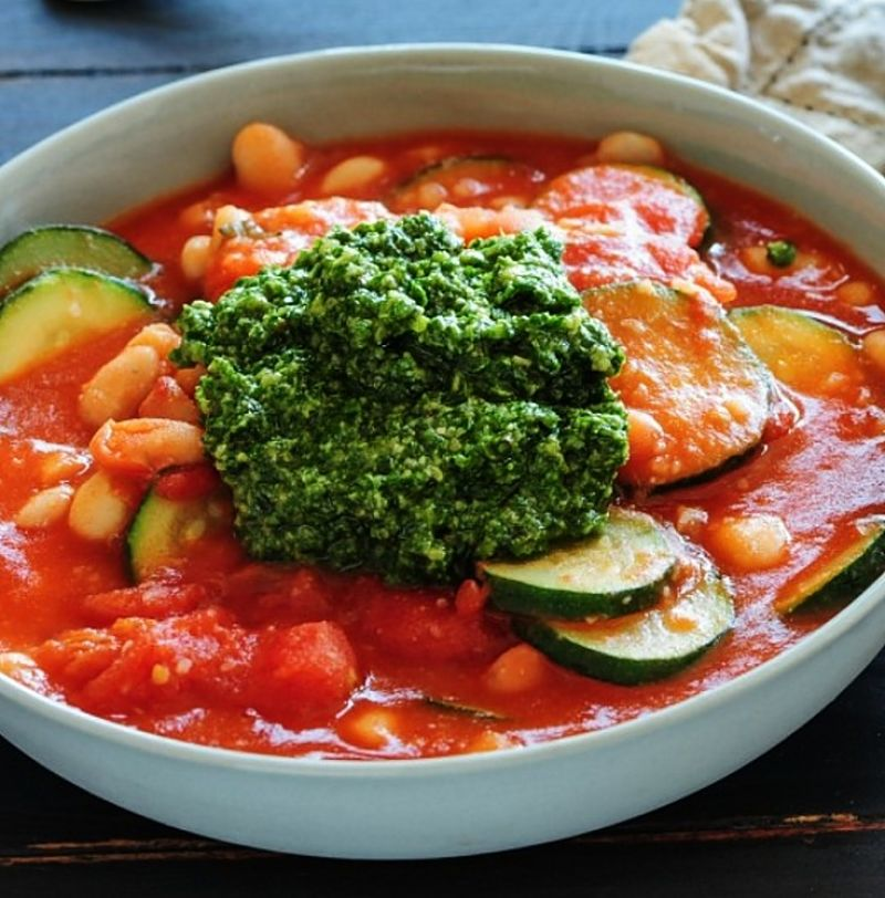 This version is rich in tomato and is topped with pesto