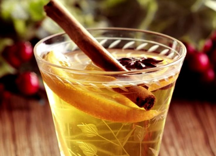 Warm mulled white wine makes a pleasant alternative spiked wine drink on cold winter days