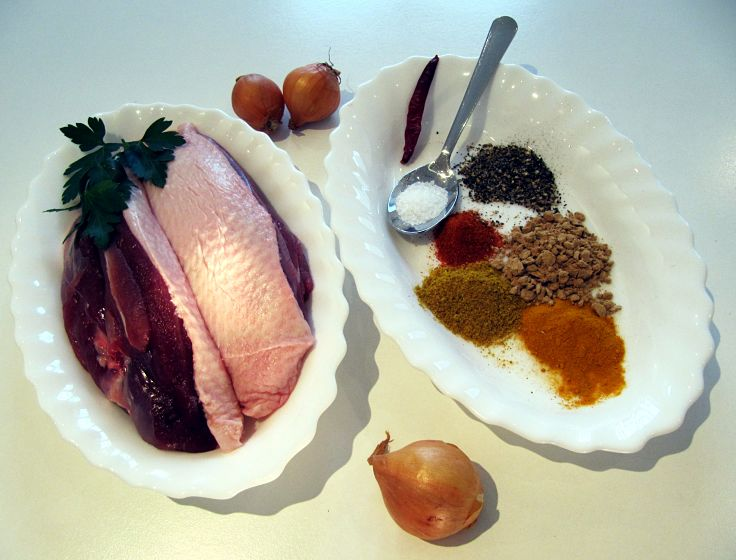 Ingredients for a Classic Duck Mulligatawny soup with small fried onions added to the soup before serving.