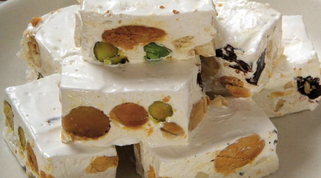 Cheeries and saltana add to the taste and texture of nuts in this torrone recipe - See more recipes here