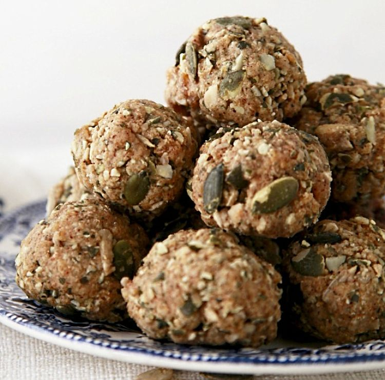 Pepitas oats and crushed nuts provide a healthy coating for protein balls adding extra tastes and texture.