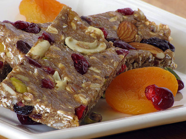 Protein bars, dried fruit such as apricots and nuts is a fabulous healthy snack to provide and energy and nutrient boost when the mood and energy levels flags.