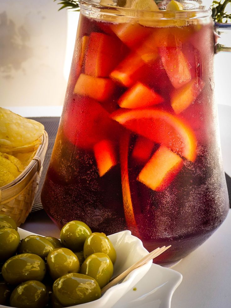 Homemade Fruit and Wine Sangria pairs so well with olives, cheese and anti-pasta ingredients.