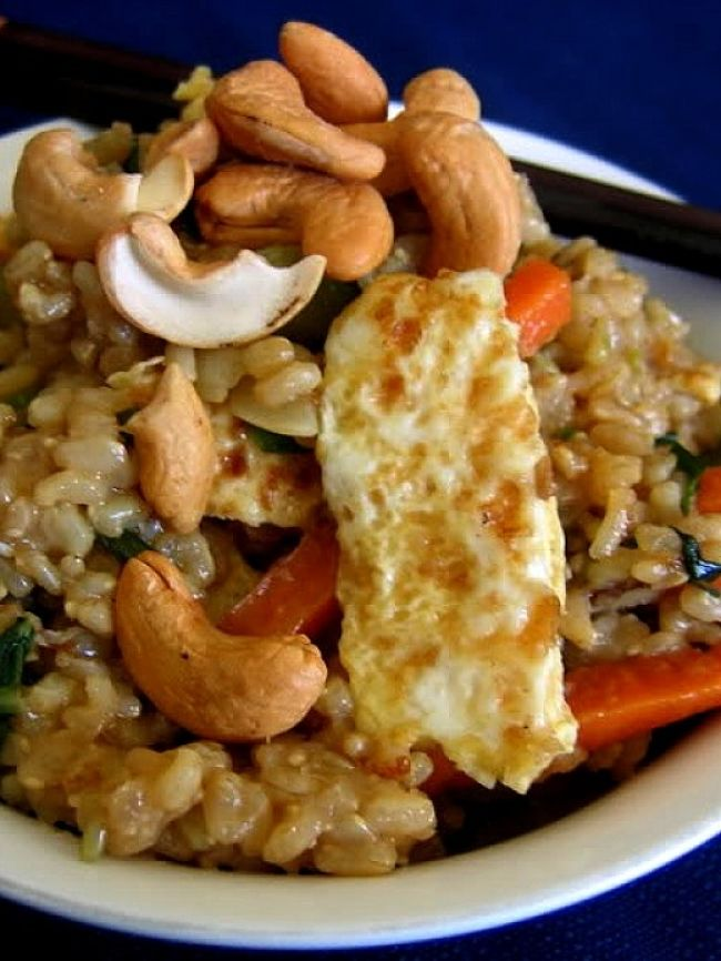 Homemade fried rice can include a huge variety of meats, nuts and vegetables that can be healthy choices for a wholefoods meal.