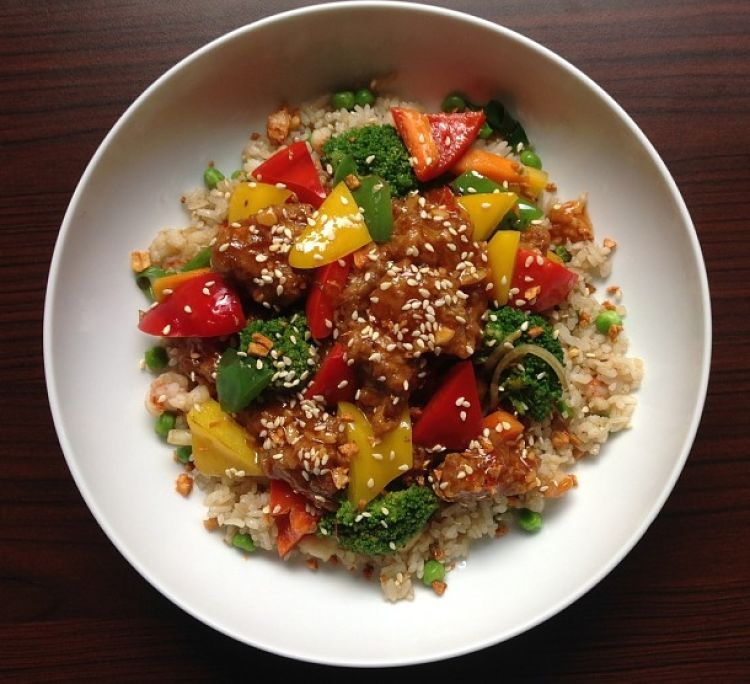 Bell pepper cubes, herbs, spices and sesame seeds add great flavor to homemade fried rice