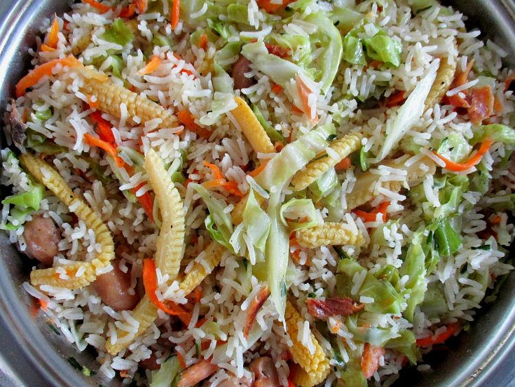 Salad ingredients such as cabbage strips are delightful with fried rice, as well as fresh herbs and chillies