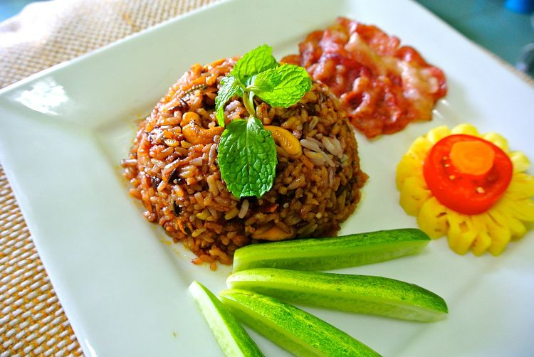 Fried rice can be served as a side dish with other items in a meal.