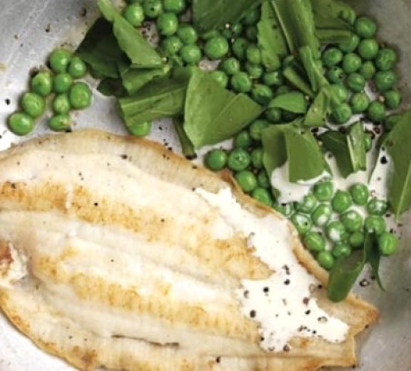 Fish fillet with peas, sorrel and a light white sauce. What a delightful combination