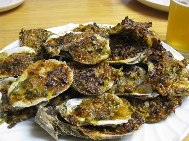 Grilled oysters topped with cheese and herbs is the perfect combination. See two great recipes here