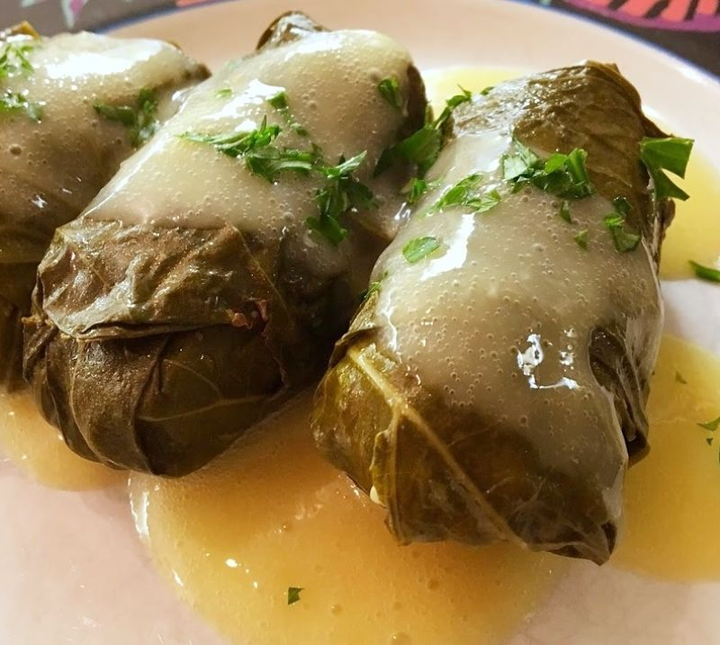 A spicy sauce and a sprinkling of herbs add to the interest and intrigue of stuffed grape leaves.