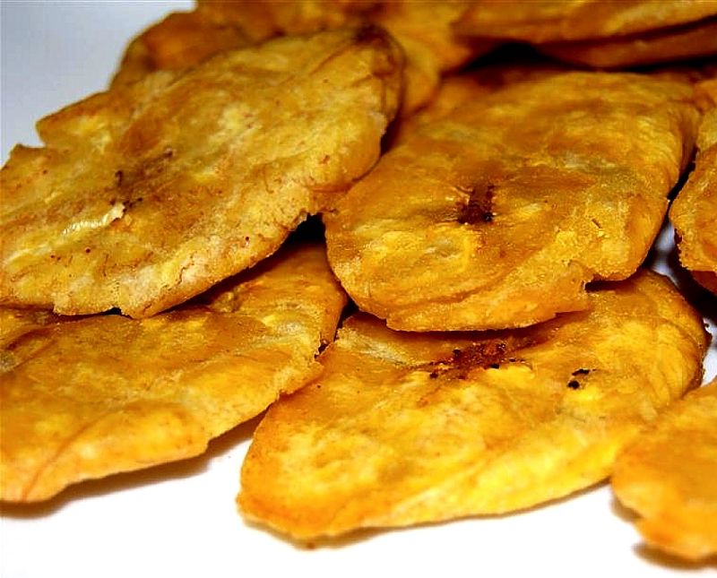Tostones are easy to prepare by doubly frying slices of green, unripe plantains or bananas