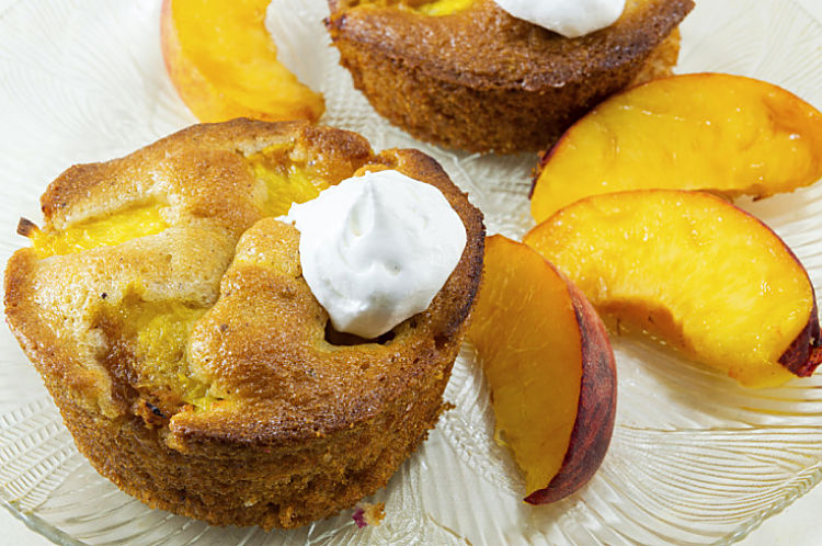 Beautiful peach upside down muffin with the peach incorporated into the cake.    Delicious combo of taste, color and texture